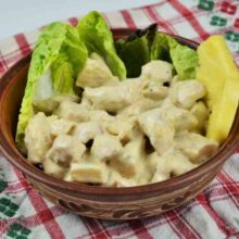 Chicken Breast With Pineapple-Served in Bowl Garnished With Lettuce and Pineapple Slices