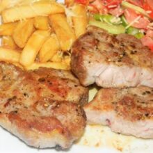 Pork steak with fries and vegetable salad
