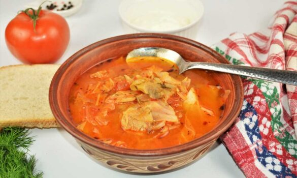 Cabbage Soup With Pork Meat-Served in Bowl With Fresh Bread