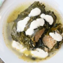 Stuffed collar greens served with sour cream