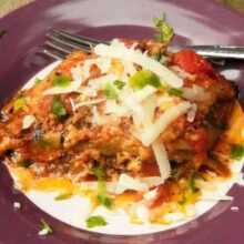 Best Eggplant Casserole Recipe-Served on Plate With Grated Cheddar on Top