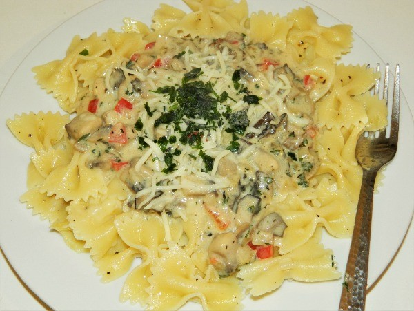 Best Creamy Mushroom Pasta Recipe-Served on Plate With Butterfly Pasta