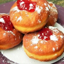 Perfect Yeast Doughnuts-Four Doughnuts with Raspberry Jam on the Plate
