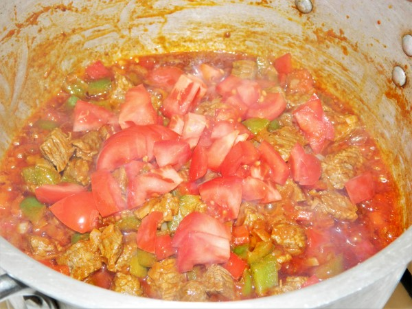 Traditional Hungarian Goulash Recipe-Add Cut Tomatoes Over the Frying Meat and Peppers