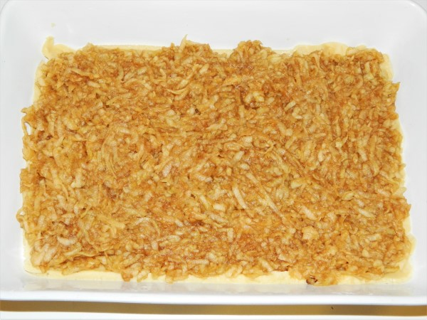 Best Easy Apple Cake Recipe-Grated Apple on the First Sheet of Dough
