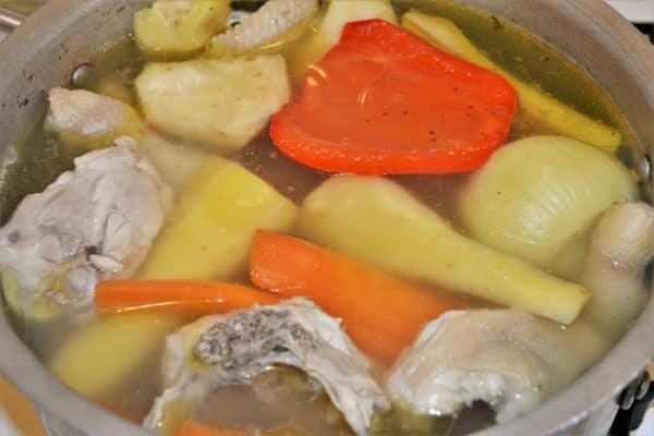 Best Creamy Chicken Soup Recipe-Boiled Chicken in the Soup Pot With Vegetables