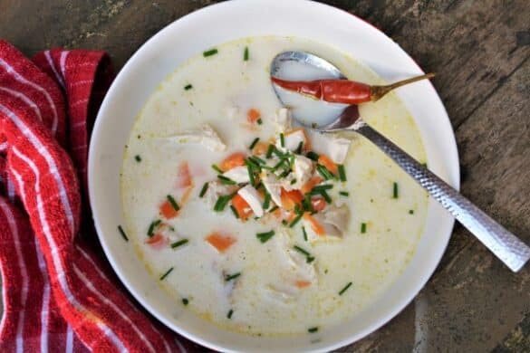 Best Creamy Chicken Soup Recipe-Served in Bowl With Bread and Chilli