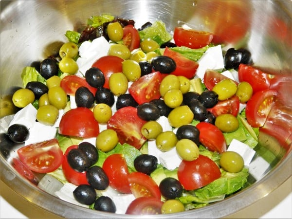 Tomato Avocado Egg Salad Recipe-Cut Romaine Lettuce, Avocado, Tomatoes, Olives and Feta Cheese in a Bowl