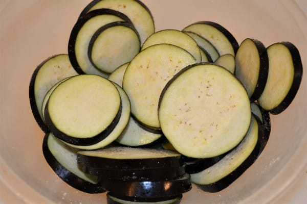 Best Breaded Eggplant Recipe-Salted Sliced Eggplant in Bowl