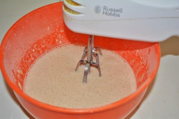 Easy Cinnamon Apple Pancakes Recipe-Mixing the Ingredients With a Hand Mixer