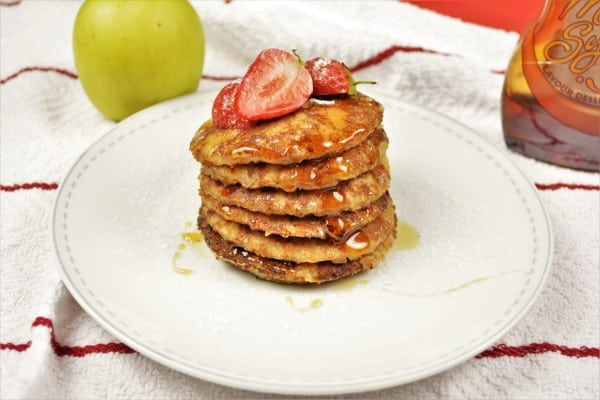 Easy Cinnamon Apple Pancakes Recipe-Served on Plate With Maple Syrup and Strawberry