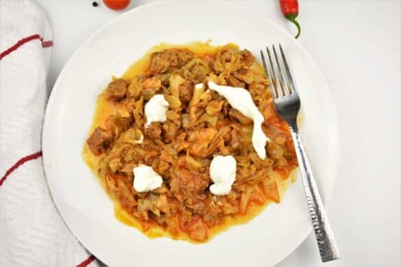 Beef and Cabbage Stew Recipe-Served on Plate With Sour Cream on the Top