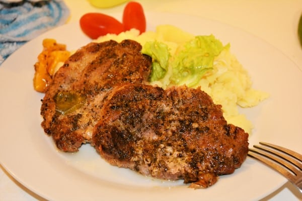 Easy Oven Baked Pork Steak Recipe-Served on Plate With Mashed Potatoes