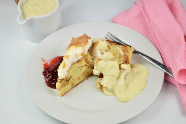 Best Simple Bread Pudding Recipe - Served on Plate With Custard Cream and Raspberry Jam