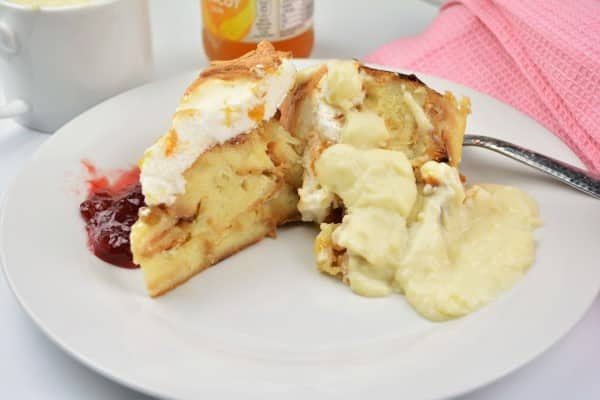 Best Simple Bread Pudding Recipe - Served on Plate With Custard and Raspberry Jam