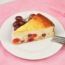 The Best Russian Cheesecake Recipe - Served on Plate With Grapes