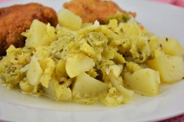 Best Sauteed Savoy Cabbage Recipe-Served on Plate With Breaded Turkey Breast