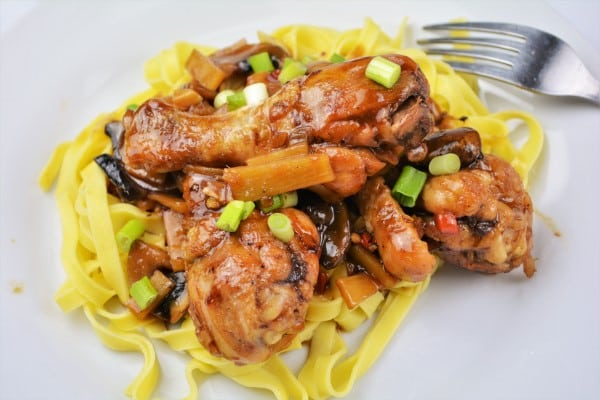 Easiest Teriyaki Chicken Recipe-Served on Plate With Tagliatelle and With Chopped Spring Onions