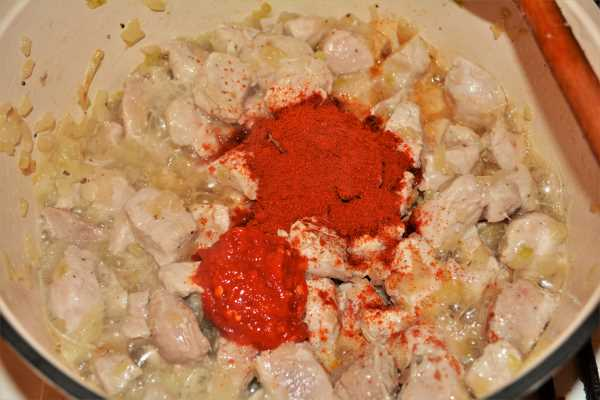 Cabbage Soup With Pork Meat-Add Paprika Powder and Paprika Cream on the Fried Pork Meat in the Pot