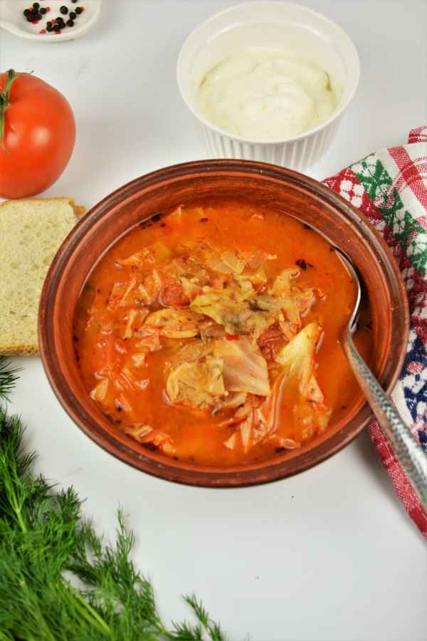 Cabbage-Soup-With-Pork-Meat-Served-in-Bowl-With-Fresh-Bread