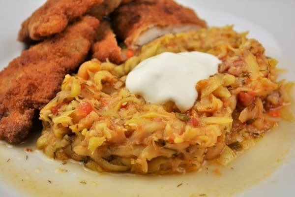 Grated Summer Squash Stew Recipe-Served on Plate With Soured Cream With Beaded Pork Chops