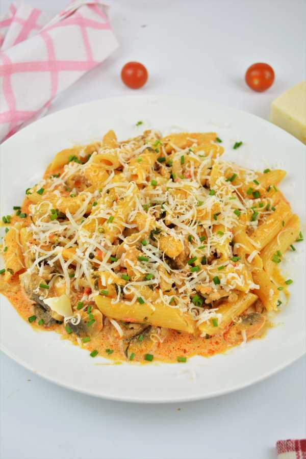Pasta With Pork Mince-Served on Plate With Grated Grana Padano on Top
