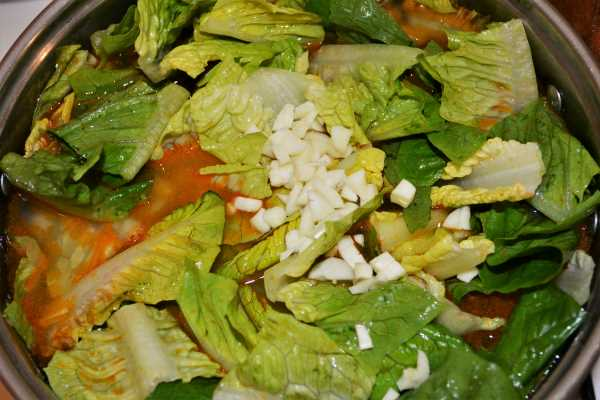 Romaine Lettuce Soup Recipe-Chopped Garlic in the Pot Over the Lettuce