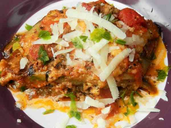 Best Eggplant Casserole Recipe-Served on Plate With Grated Pecorino on Top
