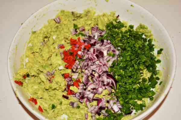 Best Homemade Guacamole Recipe-Chopped Chives, Red Onion and Chilli Pepper Over the Mashed Avocados