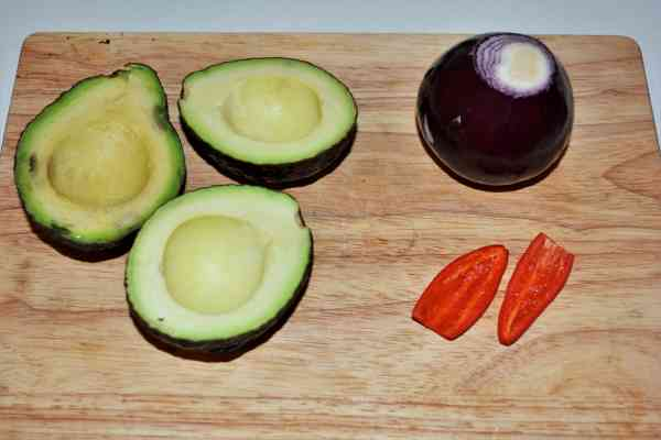 Best Homemade Guacamole Recipe-Cleaned Onion, Chilli Pepper and Avocados Cut in Two