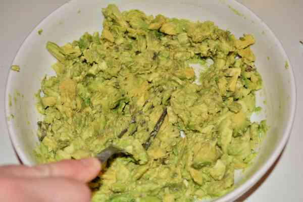 Best Homemade Guacamole Recipe-Mashed Avocados With a Fork