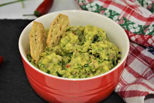 Best Homemade Guacamole Recipe-Served in Bowl With Crackers