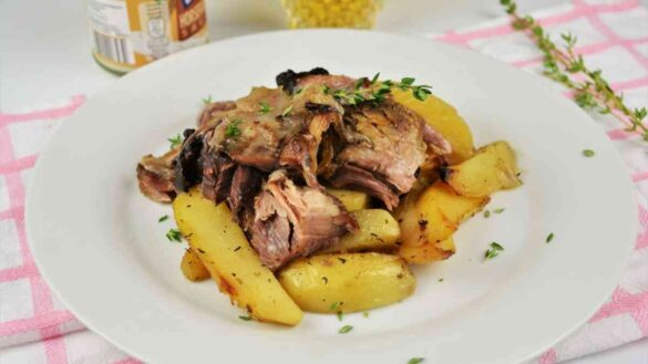 Braised Pork Knuckle Recipe-Served On Plate With Baked Potatoes