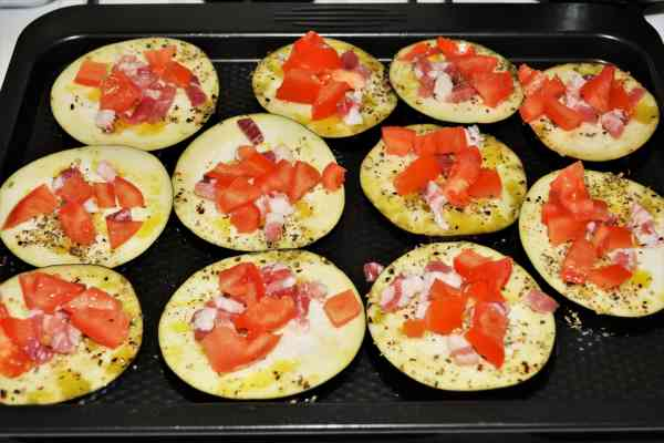 Mediterranean Roasted Eggplant Recipe-Chopped Tomatoes on the Eggplant Slices in the Baking Tray