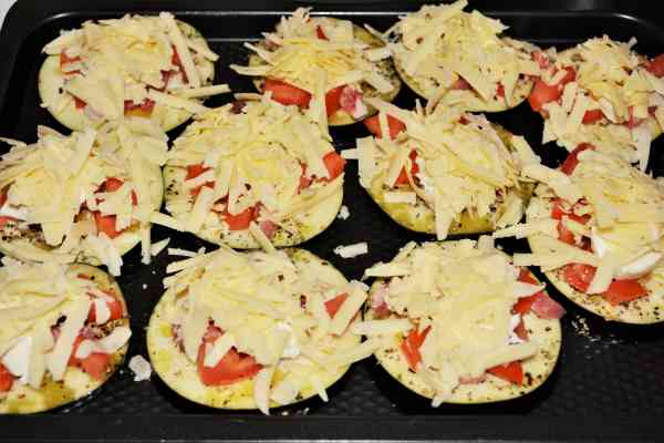 Mediterranean Roasted Eggplant Recipe-Grated Cheddar on the Eggplant Slices in the Baking Tray
