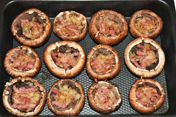 Stuffed Mushrooms With Cheese and Bacon-Portobello Mushrooms in Baking Tray Stuffed With Fried Bacon and Onion