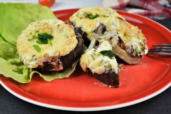 Stuffed Mushrooms With Cheese and Bacon-Served on Plate With Lettuce Leave