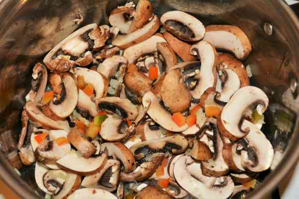 Best Mushroom Soup Recipe-Frying Sliced Mushrooms, Chopped Onions and Bell Pepper in the Pot