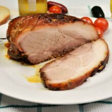 Slow-Cooked Pork Shoulder in the Oven-Sliced and Served on Plate With Mustard and Bread