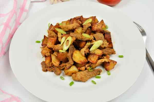 Brasov Roast Recipe-Served on Plate With Chopped Spring Onion on the Top