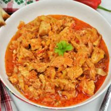 Turkey Cabbage Stew Recipe-Served in Bowl With Bread and Sour Cream