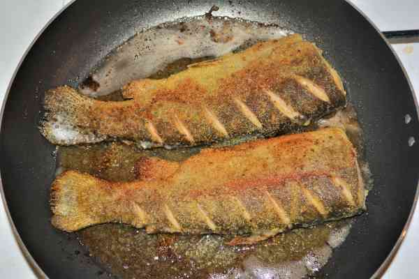 Pan-Fried Rainbow Trout Recipe-Two Trout Frying on Other Side in the Pan